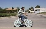 Israeli inventor Izhar Gafni rides his cardboard bicycle inAhituv