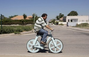 Israeli inventor Izhar Gafni rides his cardboard bicycle in Ahituv
